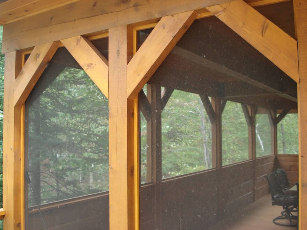 The horseshoe confederation log timber frame for Timber frame porch designs
