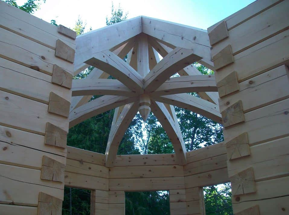 A timber turret is eased into place on Andy Kinsman's own Confederation Log & Timber Frame home