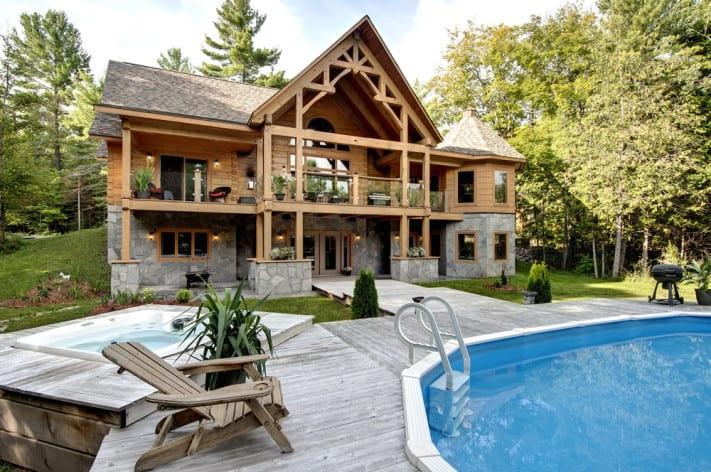 Andy Kinsman's Confederation. Log and timber frame bungalow with stone walkout basement