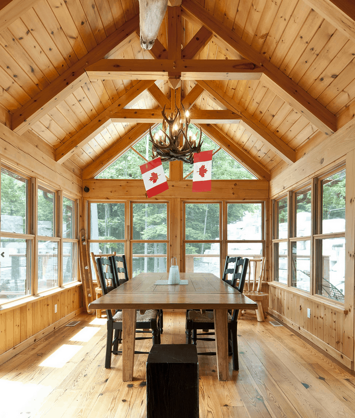 The addition of timber frame accents gives this porch a dramatic presence.