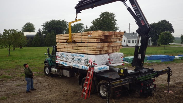 Exciting day - log home kits arrive! Here a Confederation Log & Timber Frame truck Delivers a Confederation Log Home
