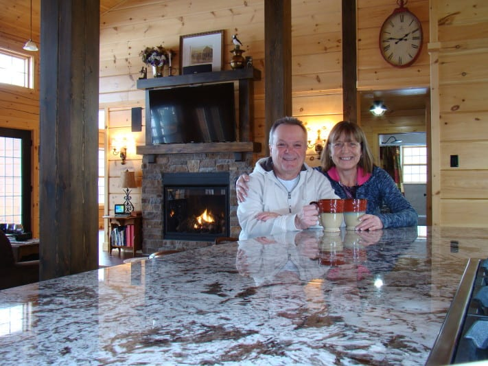 Serge and Monica beam from the kitchen lof their Confederation dream house