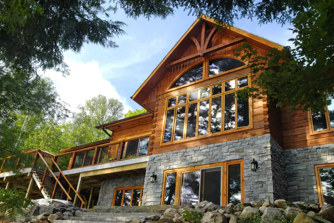 Lake of bays confederation log timber frame for Timber log home plans